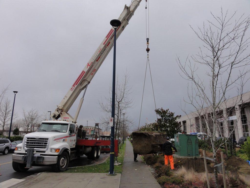 Unloading concrete base for Harbourside pylon sign