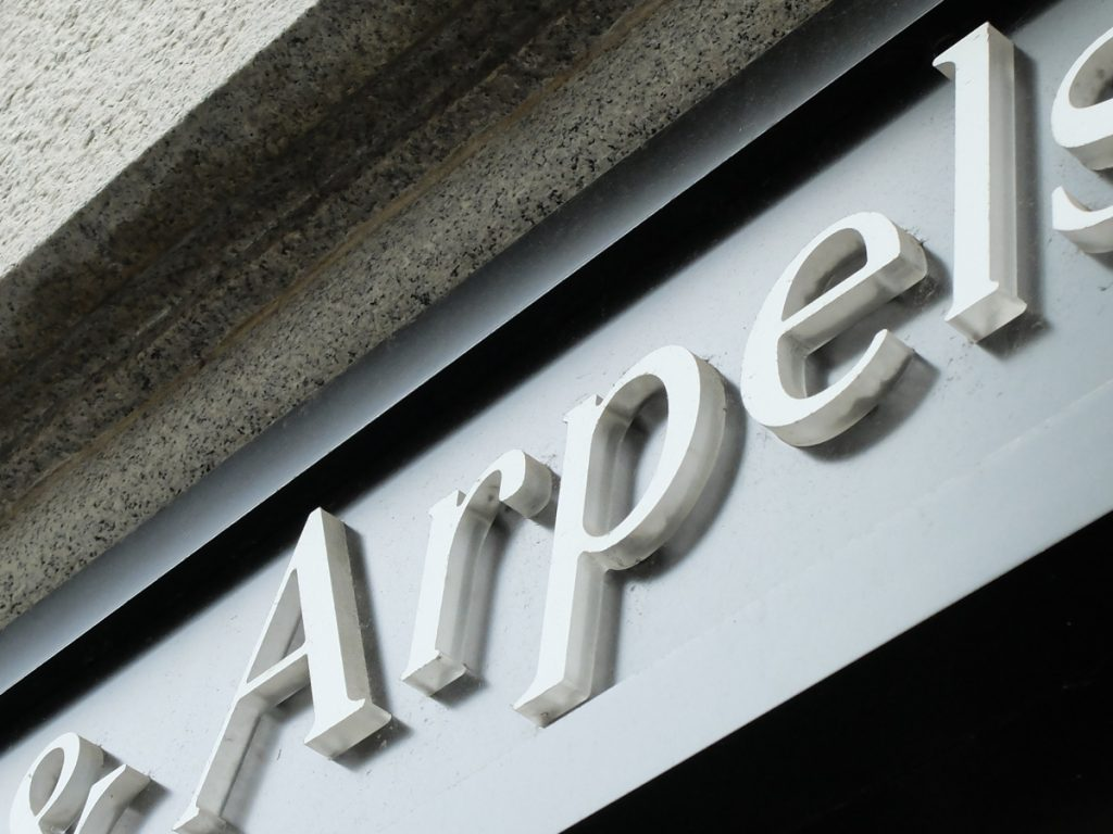 Van Clef & Arpels push thru illuminated signage